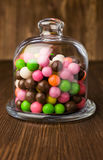 Colorful candies in a glass bell Stock Images