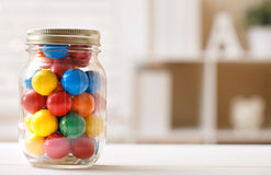 Colorful candies in a glass jar Stock Photos