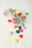 Colorful candies in a glass jar. On table Stock Image