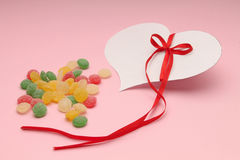 Colorful candies and a heart Royalty Free Stock Photos