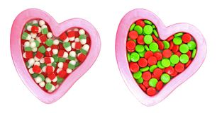 Colorful candies on heart shapes Royalty Free Stock Photography