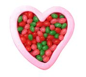 Colorful candies on heart shapes Stock Photography