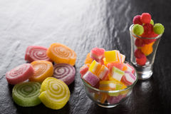 Colorful candies, jelly and marmalade and jellybeans around a ce Royalty Free Stock Photos