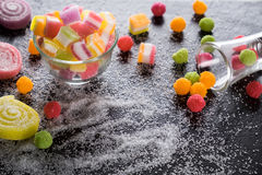 Colorful candies, jelly and marmalade and jellybeans around a ce Stock Photo