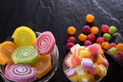 Colorful candies, jelly and marmalade and jellybeans around a ce Royalty Free Stock Photography