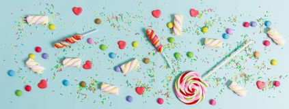 Colorful candies on blue background, top view. Colorful candies on light blue background, top view Royalty Free Stock Photography