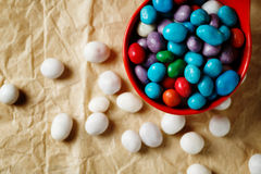 Colorful candies like sea pebbles on craft paper Stock Photo