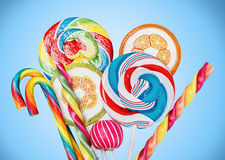 Colorful candies and lollipops Stock Photos