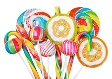 Colorful candies and lollipops isolated Stock Photos