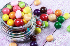 Colorful candies and lollipops in a jar on wooden Royalty Free Stock Photography