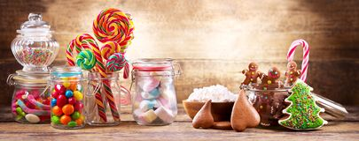 Colorful candies, lollipops, marshmallows and gingerbread cookie Stock Photos