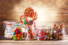 Colorful candies, lollipops, marshmallows and gingerbread cookie Stock Image