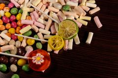 Colorful candies, lollipops and marshmallows on wooden table. Colorful candies, lollipops and marshmallows on the wooden table Stock Photography