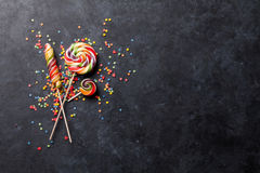 Colorful candies lollipops over stone Royalty Free Stock Photos