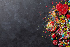 Colorful candies and lollipops over stone Stock Photography