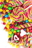 Colorful candies and lollipops. On a white background Stock Images