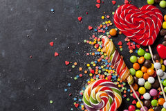 Colorful candies and lollypops Royalty Free Stock Photo