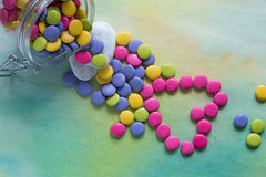 Colorful candies. Lying on watercolor background Royalty Free Stock Image