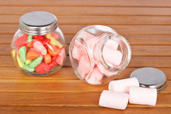 Colorful candies  and pink marshmallows Royalty Free Stock Photos