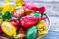 Colorful candies on plate on the vintage table. Close up Royalty Free Stock Image