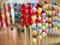 Colorful candies put on a wooden stick royalty free stock photo