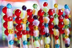 Colorful candies put on a wooden stick for sale in Thailand stock photos