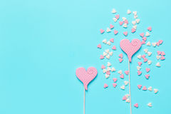 Colorful candies scattered on blue background top view mock up Stock Photography