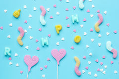 Colorful candies scattered on blue background top view pattern Stock Photography
