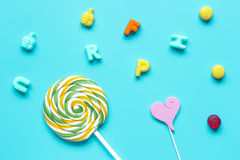 Colorful candies scattered on blue background top view pattern Stock Image
