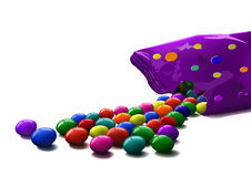 Colorful candies scattered from package Royalty Free Stock Photo