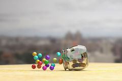Colorful candies scattering out of glass jar Stock Photo