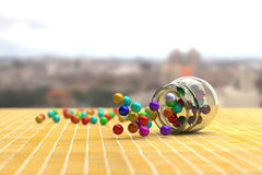 Colorful candies scattering out of glass jar Royalty Free Stock Photo