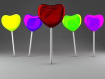 Colorful candies on stick on gray background Royalty Free Stock Images