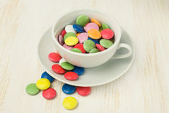 Colorful candies in a white cup Stock Images