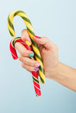 Colorful candies in woman's hand Stock Photo