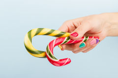Colorful candies in woman's hand Stock Photos