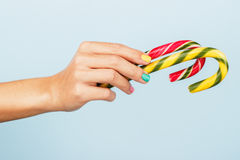 Colorful candies in woman's hand Royalty Free Stock Photography
