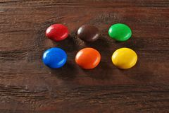 Colorful candies on background. Colorful candies on wooden background Royalty Free Stock Images