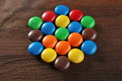 Colorful candies on background. Colorful candies on wooden background Royalty Free Stock Image