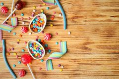 Colorful candies on background. Colorful candies on wooden background Stock Image