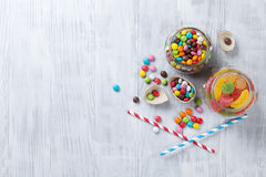 Colorful candies on wooden table Stock Images