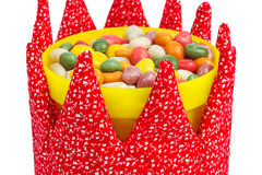 Colorful candies in a yellow bucket decorated with fabric crown Royalty Free Stock Photography