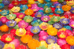 Colorful candle krathong floats in water. Stock Images