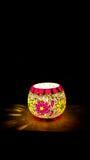 Colorful Candle Votive. Illuminated at the Eve of Diwali Stock Photo