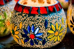 Illuminated Colorful Candle Votive. Colorful Candle Votive illuminated on the Eve of Diwali or Christmas Royalty Free Stock Images