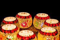 Illuminated Colorful Candle Votive. Colorful Candle Votive illuminated on the Eve of Diwali or Christmas Stock Image