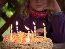 Colorful candles on  birthday cake in the dark Stock Photos