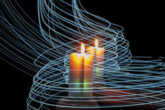 Colorful candles and blue stripes of light on black background Royalty Free Stock Photo