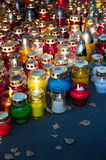 Colorful candles on cemetery. During Halloween holiday royalty free stock image