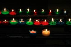 Colorful candles in a church. The different colors candles in a church. They let people feel peace and clam Royalty Free Stock Photos